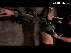 Blonde Girl Tied To Cross Belly And Ass Spanked Tits Rubbed In The Dungeon
