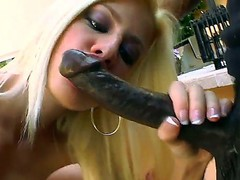 Blonde hottie Jessie Volt kneels and deep blows this black dudes huge cock