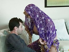 James Deen is pleased by the big boobs of shyla stylez wearing belly dancer wardrobe. She is looking stunning in purple. Her boobs are groped hard by deen and licking it with passion. She really wants her pussy being rubbed too.