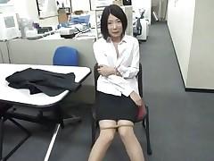 bored asian girl sucks a vibrator at work