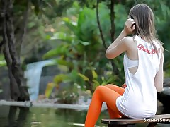 slim babe with lengthy hair masturbating outdoor