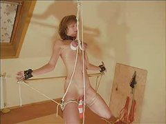 Slave Endures Being Suspended by Her Breasts