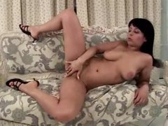 Curvy girl masturbates on the comfy couch