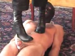 Dominant-bitch in high heels walks on him